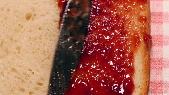 Spread strawberry jam on bread video