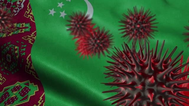 3D Spreading Coronavirus Disease on a Waving Turkmenistan Flag A coronavirus spinning with Turkmenistan flag behind as epidemic outbreak infection in Turkmenistan turkmenistan stock videos & royalty-free footage