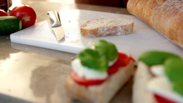 Spreading nutella on a slice of bread video