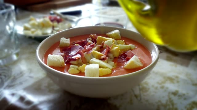 spreading olive oil on salmorejo cordobes, a typical spanish tomato soup - spanish food stock videos and b-roll footage