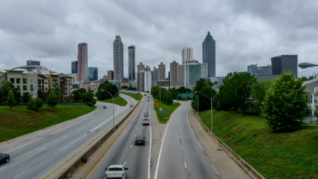 Spring at Atlanta - Time-lapse video of dark Spring storm clouds passing over busy highways and modern skyline of downtown Atlanta, Georgia, USA. video