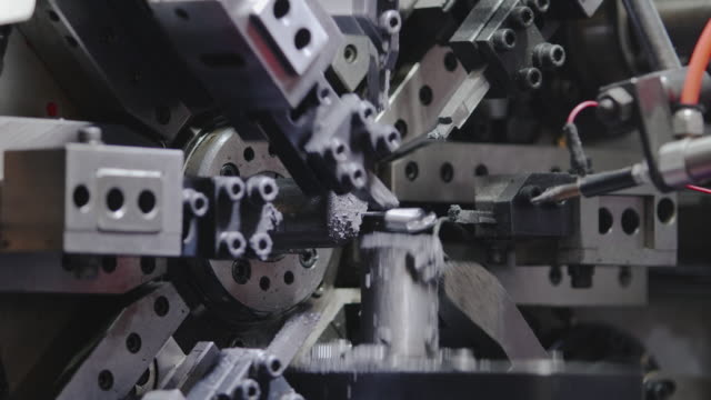 Spring making machine produces small springs.