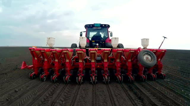 Spring sowing of corn Sowing of corn with modern agriculture mechanization,video clip flower pot stock videos & royalty-free footage