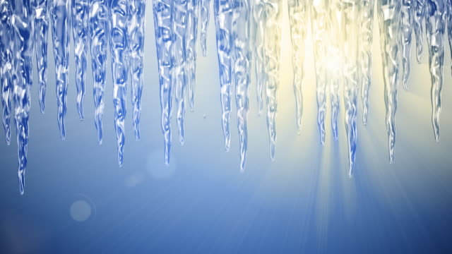 Spring sun melts icicles - loopable, HD video