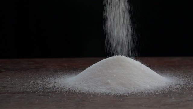 sprinkle salt slow motion - salt video stock e b–roll