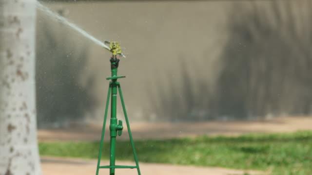 sprinkler spray water on the lawn video