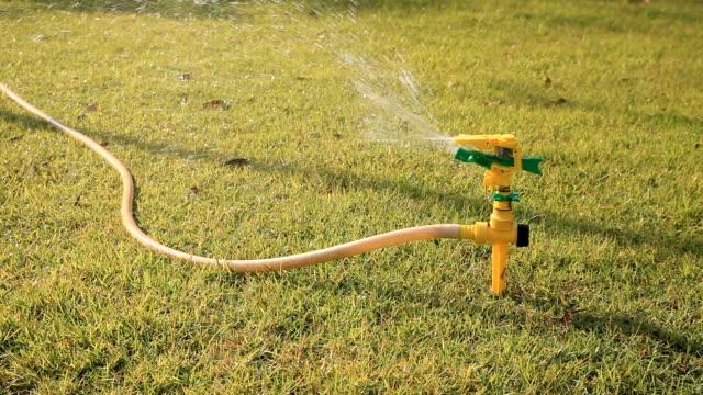 Sprinkler water on grass field