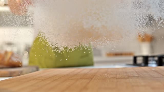SLO MO LD Sprinkling flour over the cutting board video