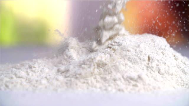 Sprinkling Flour Sprinkling Flour (dolly) flour stock videos & royalty-free footage