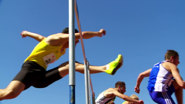 sprint hurdle race for men slo mo - track and field stock videos and b-roll footage