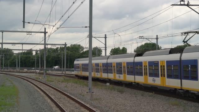 sprinter train with passengers passing - intercity filmów i materiałów b-roll