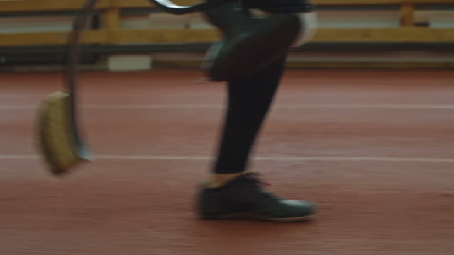 Sprinter with Prosthetic Leg Running Low section of leg and prosthetic limb of amputee athlete running on track artificial limb stock videos & royalty-free footage