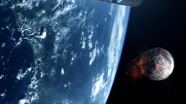 spy satellite orbiting earth. burning moon in background. nasa public domain imagery - układ słoneczny filmów i materiałów b-roll