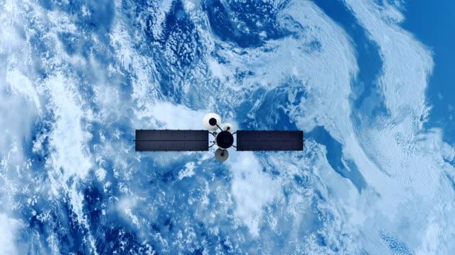 spy satellite orbiting earth. - układ słoneczny filmów i materiałów b-roll