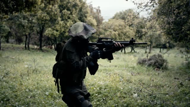 Squad of fully armed Israeli commando soldiers during combat in a forest scenery Squad of fully armed soldiers during combat in a forest scenery military uniform stock videos & royalty-free footage