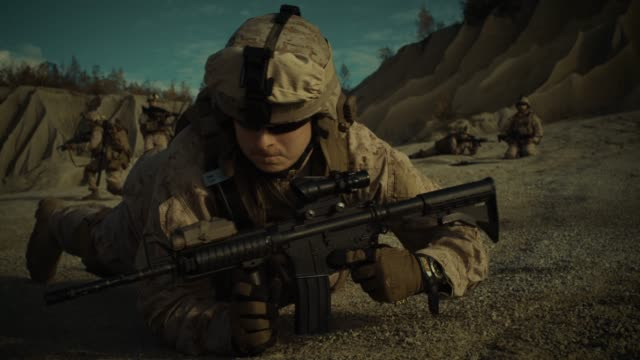 squad of fully equipped, armed soldiers on a reconnaissance mission in the desert country. captain of the team crawls into position of best enemy visibility. - marines military stock videos & royalty-free footage