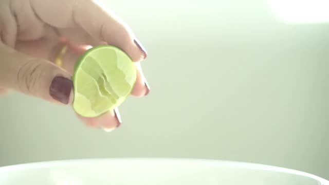 Squeezing a Piece of Lime