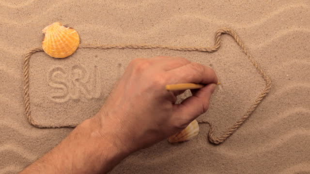 Sri lanka inscription written by hand on the sand, in the pointer made from rope. video