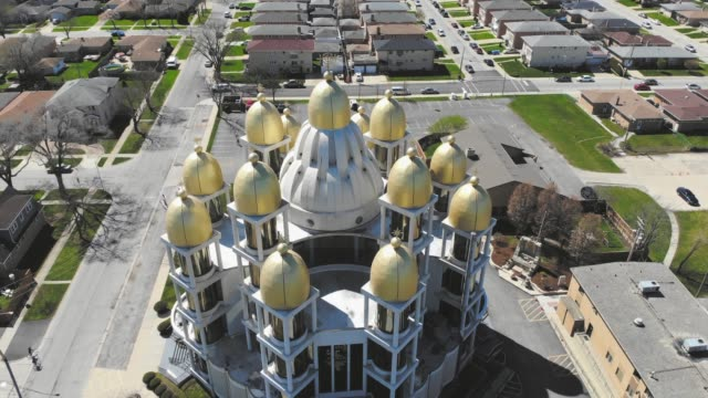 St. Joseph Ukrainian Catholic Church in northwest Chicago. Flight over the church in a festive, sunny day by drone. Outskirts of downtown Chicago.