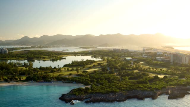 st maartin aerial v13 flying low panning with mullet bay and golf course views at sunrise. - saint martin caraibi video stock e b–roll