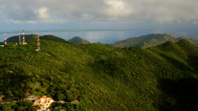 st maartin aerial v19 flying over peak area panning with panoramic island views. - saint martin caraibi video stock e b–roll