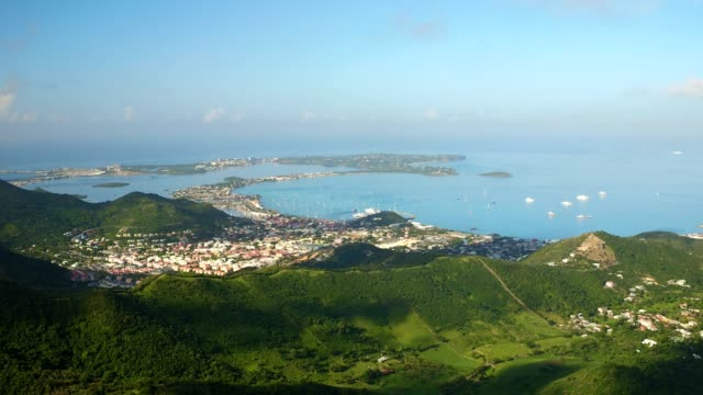 st maartin aerial v20 flying over peak area panning with panoramic island views. - saint martin caraibi video stock e b–roll