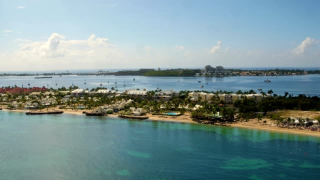 st maartin aerial v26 flying low over bay and lagoon towards airport. - saint martin caraibi video stock e b–roll