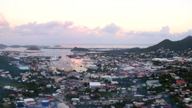 st maartin aerial v28 flying low over cay bay area panning at dawn.ê - saint martin caraibi video stock e b–roll