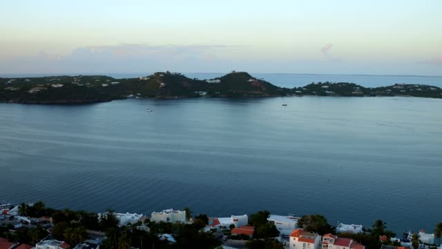st maartin aerial v3 flying low over lagoon panning with panoramic views at sunset. - saint martin caraibi video stock e b–roll