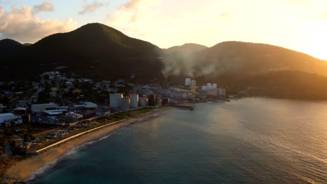 st maartin aerial v32 flying low over cole bay and power plant at sunrise. - saint martin caraibi video stock e b–roll