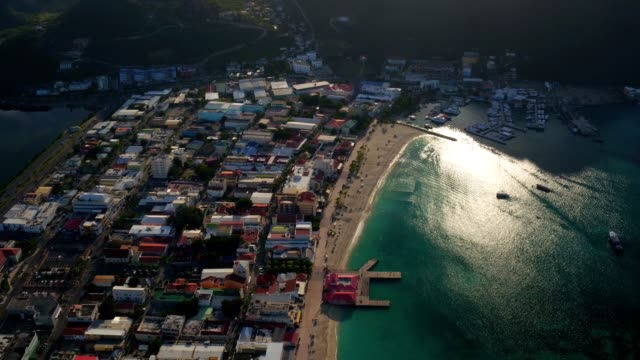 st maartin aerial v38 flying over philipsburg panning down. - philipsburg saint martin olandese video stock e b–roll