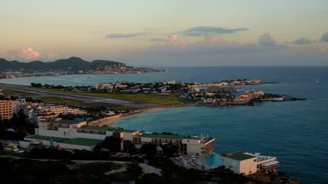 st maartin aerial v5 flying low over maho area panning near maho beach. - saint martin caraibi video stock e b–roll