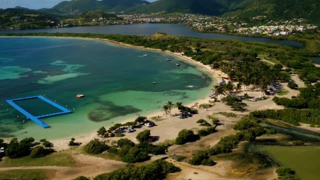 st maartin aerial v51 flying over le galion beach panning down. - saint martin caraibi video stock e b–roll