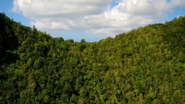 st maartin aerial v53 flying low over tall hillsides revealing views of runway and airport. - saint martin caraibi video stock e b–roll