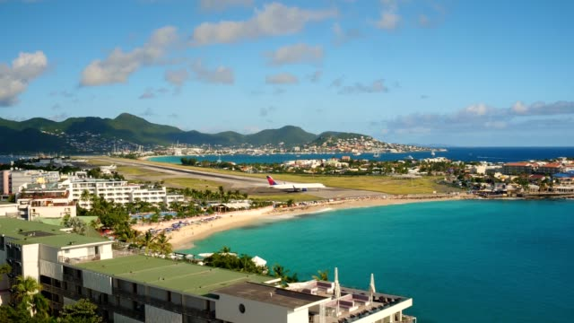 st maartin aerial v57 flying low over maho reef area with views of commercial airplane taxiing. - saint martin caraibi video stock e b–roll