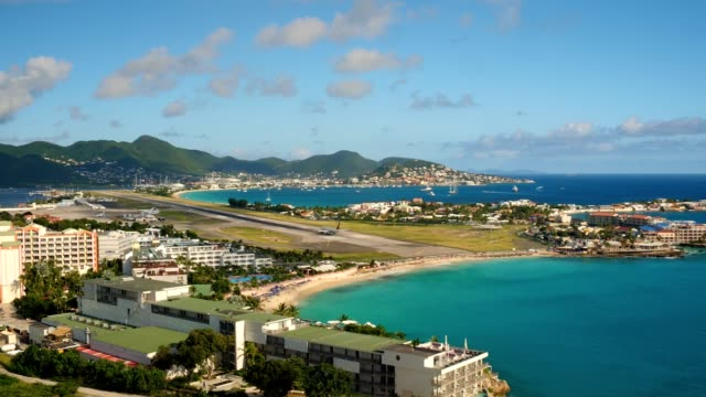 st maartin aerial v58 flying low over maho reef area with views of commercial airplane taking off. - saint martin caraibi video stock e b–roll