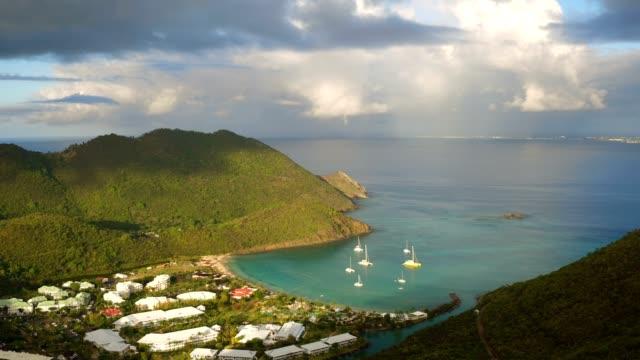 st maartin aerial v73 flying low over anse marcel area panning at sunrise. - saint martin caraibi video stock e b–roll