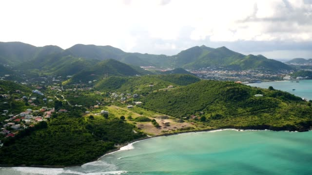 st maartin aerial v77 flying over bay panning with panoramic island views. - saint martin caraibi video stock e b–roll