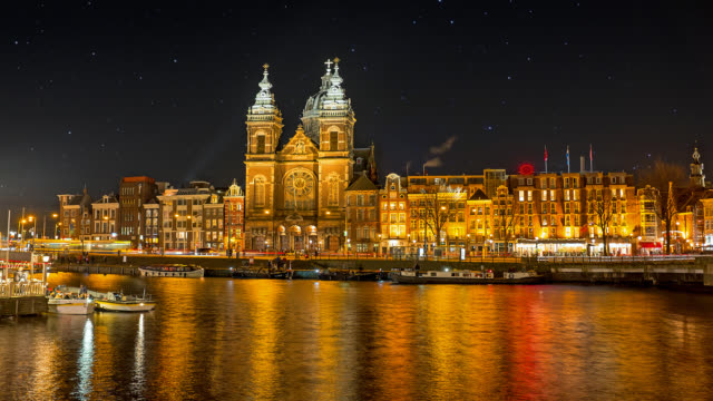 St. Niklaas church in Amsterdam the Netherlands at night St. Niklaas church in Amsterdam the Netherlands at night architectural column stock videos & royalty-free footage