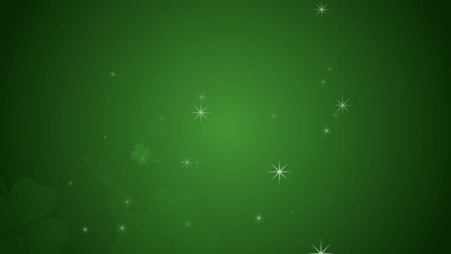 St Patrick's day animation, clover leafs rotating on the green background with sparkles