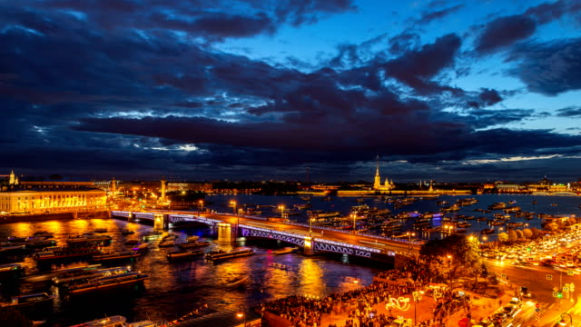 st. petersburg, opening palace bridge. time-lapse photography view from the roof to neva water area, peter and paul fortress, palace bridge and the spit of vasilievsky island - san pietroburgo russia video stock e b–roll