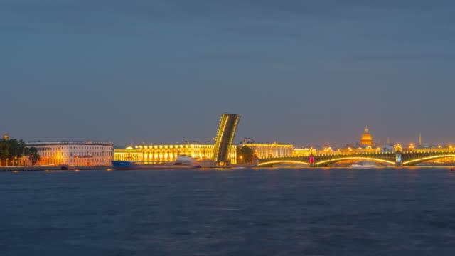 st. petersburg, russia circa june 2019: big ships pass through the open bridge in white night, time-lapse. - san pietroburgo russia video stock e b–roll