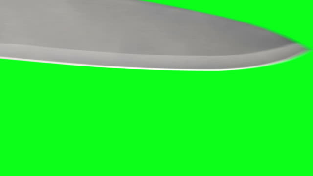 vidéos et rushes de couteau stabbing écran vert - lame