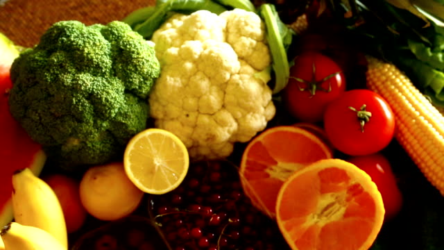 Stack of fresh fruits and vegetables.