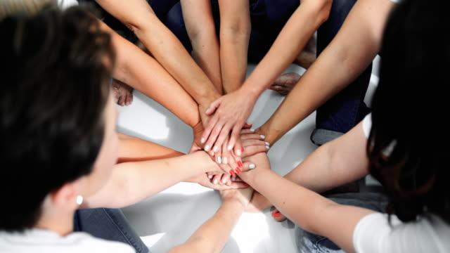 stack of hands - amicizia tra donne video stock e b–roll