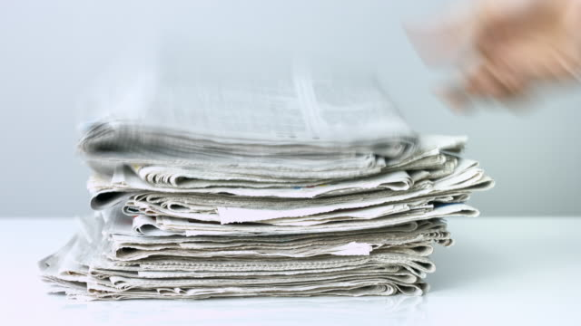 Stack of newspapers on white background video
