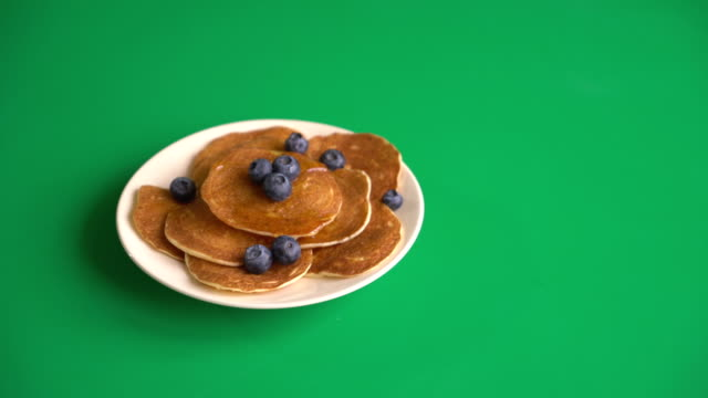 Stack of pancakes with fresh blueberry on green screen video