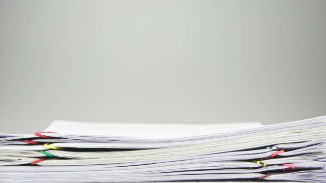 Stack of sales and receipt overload on table time lapse