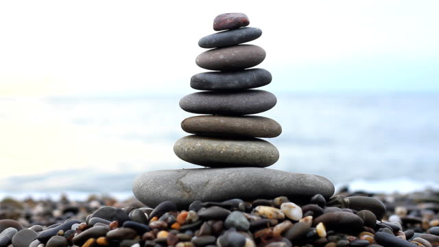 Stack of stones and Sea video
