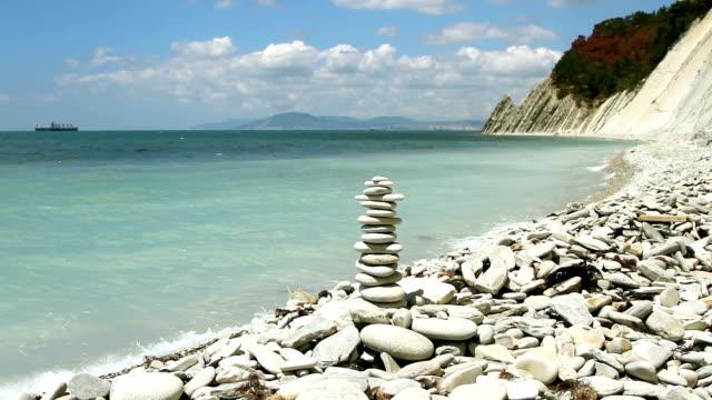 stack of zen stones on the beach video